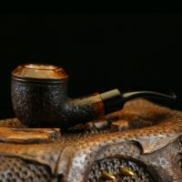 Handmade briar Rhodesian style pipe. This is a compact pipe that is an excellent smoker designed after my favorite pipe. The wood is briar and the stem is vulcanite with a Delrin tenon. Bowl diameter: Bowl depth: Overall length: