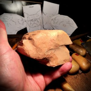 Hand carving a dog tobacco pipe